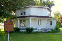Color photo of the Darrow Octagon House located at 8405 Main Street in Kinsman, Ohio