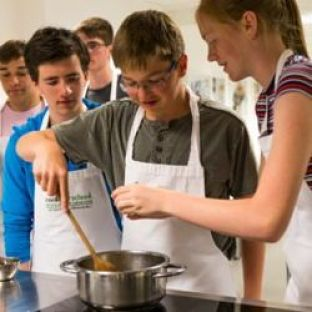 A group of teens cooking